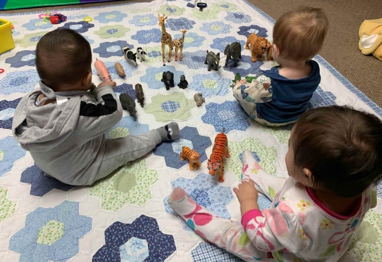 Infants Playing with Animal Toys