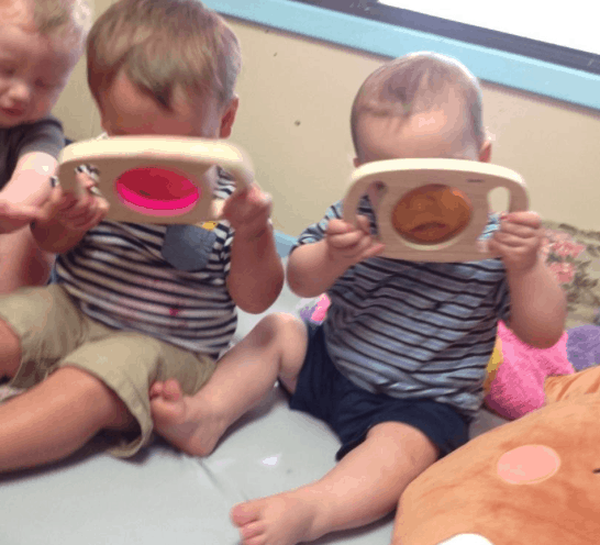Toddlers Looking Through Colors